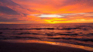 Sunrise in strong orange colours on the Baltic Sea