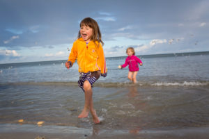 3-6 years old girl with friend in the water on the Baltic Sea