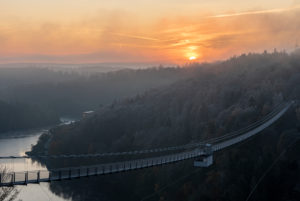 Germany, Saxony-Anhalt, Upper Harz, sunrise, suspension bridge TitanRT at the Rappbodetalsperre, Harz.