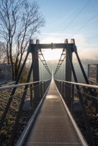 Germany, Saxony-Anhalt, Upper Harz, suspension bridge TitanRT, Rappbodetalsperre, with 483 meters one of the longest rope bridges in the world, Harz.
