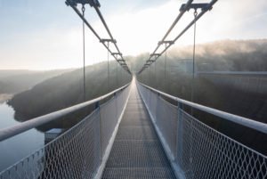 Germany, Saxony-Anhalt, Upper Harz, on the suspension bridge TitanRT, sunrise, with 483 meters one of the longest rope bridges in the world.