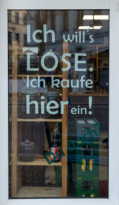 "Germany, Saxony-Anhalt, Magdeburg, unwrapped shop ""Frau Erna`s loser Lebenspunkt"", entrance with lettering ""Ich will`s LOSE. I'm shopping here! """