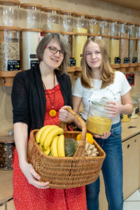 "A woman and a student stand in front of a shelf with filling containers for grain in the packaging-free shop ""Frau Erna`s loser LebensMittelpunkt"" in Magdeburg, Germany"