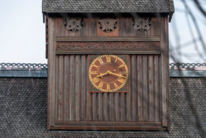 Germany, Lower Saxony, Harz, Goslar, Gustav Adolf Stave Church in Hahnenklee, tower clock and pagan symbols, detail.