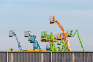 Germany, Saxony-Anhalt, Magdeburg, trading port, working platforms and telescopic forklifts.
