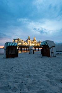Germany, Mecklenburg-Western Pomerania, Ruegen island, Sellin, pier, beach chairs, blue hour