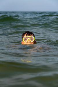 Germany, Mecklenburg-Western Pomerania, Ruegen Island, Baltic Sea resort Binz, boy with diving goggles, Baltic Sea