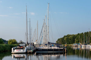 Germany, Mecklenburg-Western Pomerania, Ostseebad Sellin, sailing boats and yachts lie in the natural harbor Seedorf on the island of Ruegen.