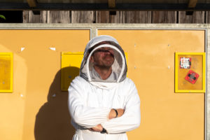 Beekeeper is waiting for the bus