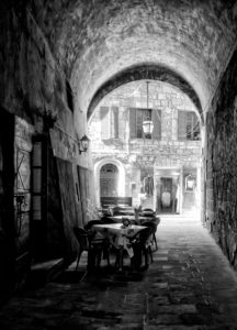 Sorano, Tuscany, Italy, restaurant, archway, old town, black and white