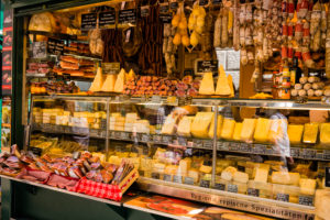 Bolzano, fruit market, ham, bacon and cheese