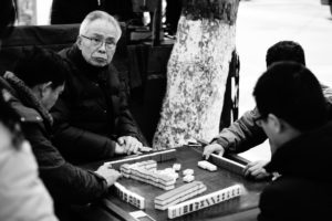 Men playing Mahjong at the roadside in Nanjing