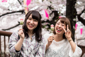 Two Japanese women beeing happy having a snack