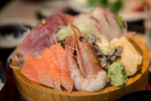 A plate with fresh fish at the fish market in Tokyo