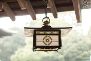 A hanging oil lamp in a temple complex in Tokyo