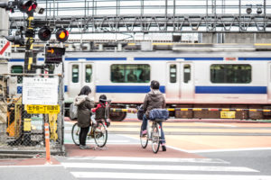 Locals in front of a railroad crossing in Tokyo