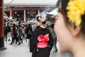 A young lady in a traditional robe in a temple in Tokyo