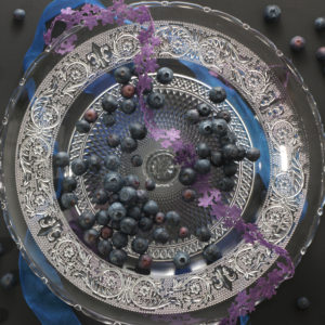 Garden blueberries on antique plate