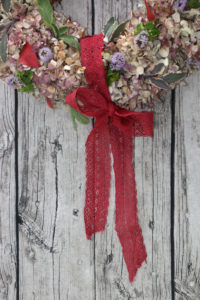 Door wreath made of hydrangeas and colored leaves