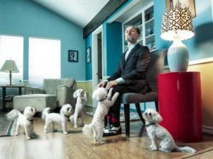 Caucasian businessman ignoring begging dogs