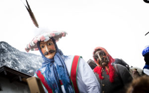 Germany, Bavaria, Mittenwald, carnival procession, masks, witch