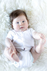 Baby, boy, 5 months, playing with his feet