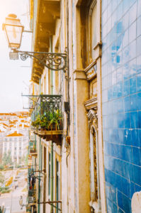 Traditional facade front of portuguese buildings with balconys and lamps. Old charming street in Lisbon, Lisboa, Lissabon, Portugal, Europe