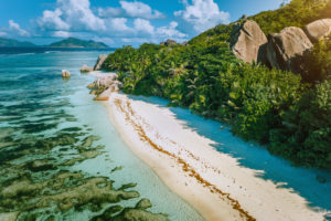 Seychelles, La Digue. Aerial view of beautiful paradise tropical beach Anse Source d'Argent in morning soft light. Summer vacation and travel concept.