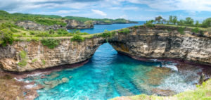 Rock coastline of Nusa Penida. Stone arch over the sea. Broken beach, Nusa Penida,Indonesia