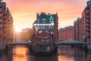 Hamburg Old Port, Germany, Europe, historic warehouse district with moated palace in the golden light of sunset