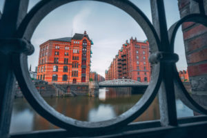 Historic warehouse district in Hamburg, Germany, Europe, old brick buildings and canal of the Hafencityviertel, UNESCO heritage