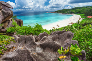 View to Grand Anse beach from stone above. La Digue island, Seychelles.