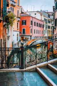 Venice, Italy. The bridge and the colored houses on the shore of a narrow channel.