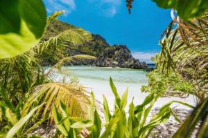 El Nido, Palawan, Philippines. Unknown star beach. Beautiful shallow ocean lagoon and exotic plants.