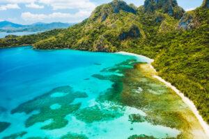 Cadlao lagoon, El Nido, Palawan Island, Philippines. Aerial drone view of a tropical island coastline, coral reef, jungle.