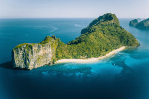 Aerial drone view of Dilumacad called Helicopter Island in El Nido, Palawan, Philippines.