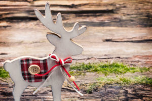 Christmas decoration, reindeer in front of wooden background