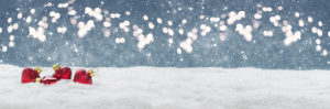 Christmas background, hearts in the snow in front of Bokeh, banner