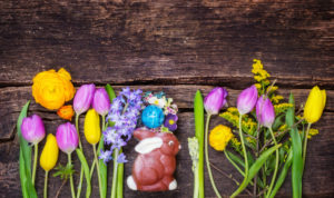 Easter basket with Easter bunny and Easter egg on wood, Easter decoration