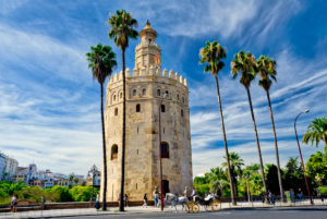 Spain, Seville, Torre del Oro, the Golden tower and a horse-drawn carriage