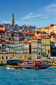 Portugal, Oporto, the Ribeira district and Douro river with a tourist excursion boat ( a converted Port Wine barge )