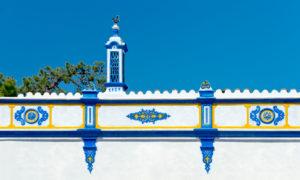 blue chimney and decorative frieze (platiband) near Almancil, the Algarve, Portugal