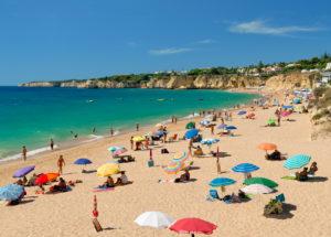 Armacao de Pera beach with sunshades in Spring