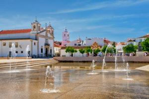Portugal; Algarve; Lagos; the water feature fountains in the Praca do Infante Dom Henrique square and the igreja de Santa Maria de Lagos