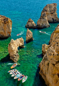 Ponta da Piedade, Lagos, the Algarve, with fishing boats waiting to give boat trips