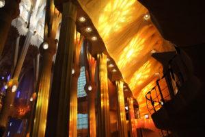 The sunlight shining through the windows of the Sagrada Familia