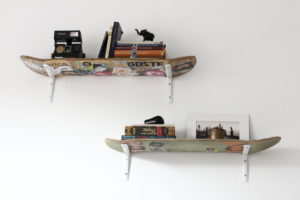 Skateboards as shelves on wall