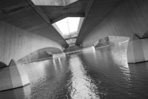The Tormin bridge from below in black and white.