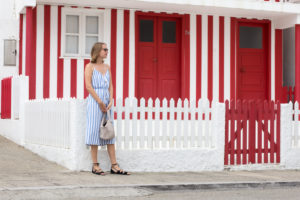 Striped houses and woman in striped dress