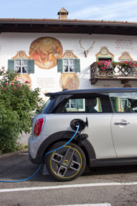 At the charging station with the electric Mini Cooper SE